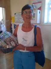 Karen Richter walked away with the gift basket from new health food store Dandelion Foods in Almonte after trading in the birdhouse she won!