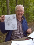 Neil Carleton leads people in creative experimentation with leaf and bark rubbings.